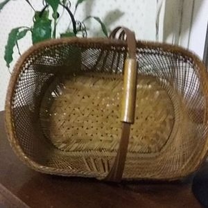 large brown wickered basket with handle